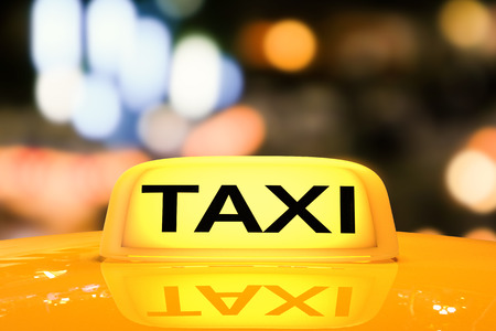 taxi sign: 3d rendering yellow taxi sign on taxi cap