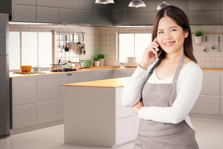 housekeeper: asian housekeeper with kitchen background Stock Photo