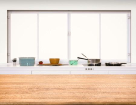 cabinetry: empty wooden counter top with kitchen background