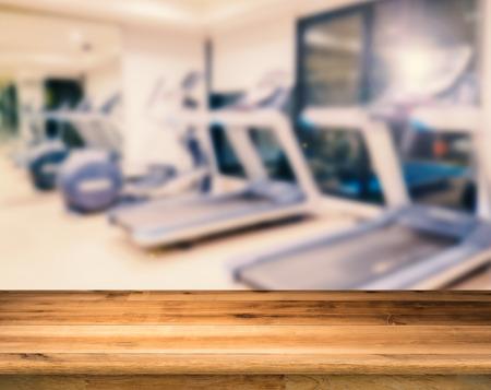 stamina: wooden floor with workout gym blurred background