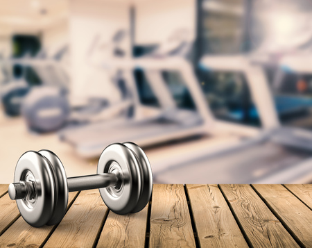3d rendering metal dumbbell with gym background Stockfoto