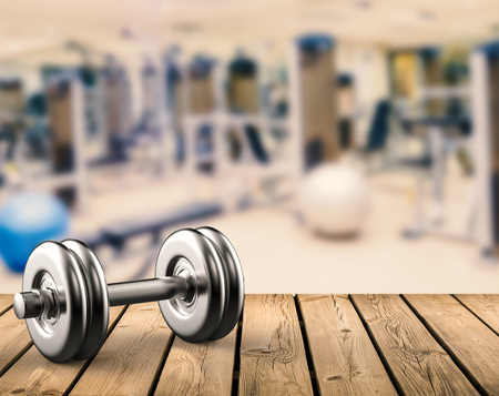 3d rendering metal dumbbell with gym background Stock Photo