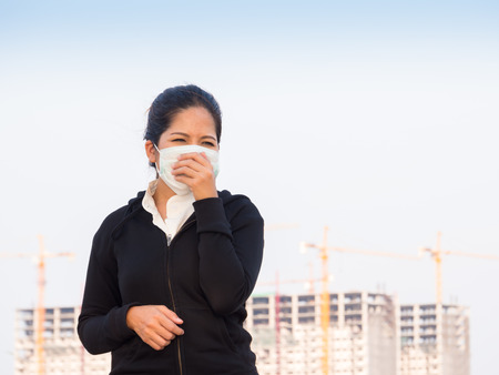 deterrence: asian woman wearing face mask and coughing by pollution Stock Photo