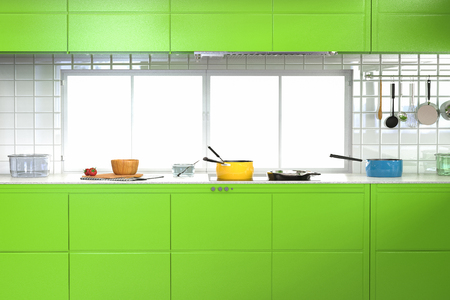kitchen cabinets: 3d rendering green kitchen interior with cabinets and kitchen utensils
