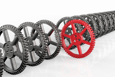 differentiation: leadership concept with red gear and metal gears Stock Photo
