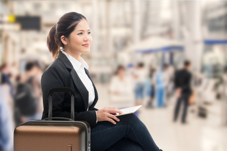 business traveller: business traveler waiting with airport background