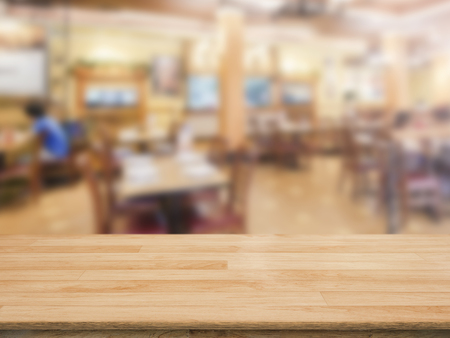 counter top: wooden counter top with restaurant blurred background