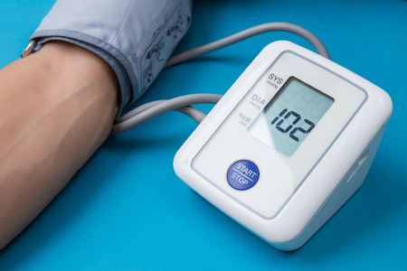 measuring blood pressure with digital equipment Stock Photo