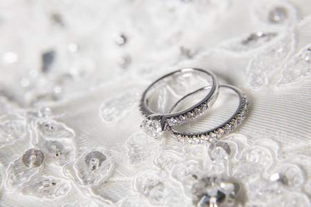 diamond rings: two wedding rings with diamond on platinum rings Stock Photo