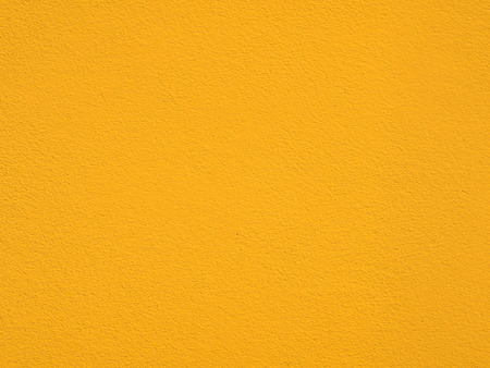 yellow wall: yellow wall background with cement texture Stock Photo