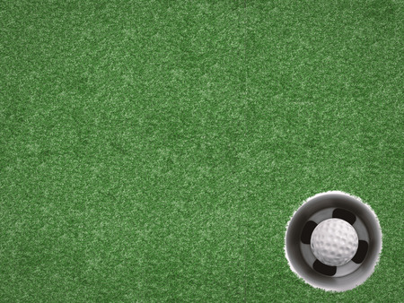 putt: golf ball in golf cup on green top view