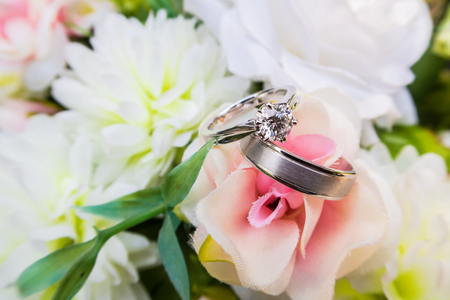 weddingrings: two wedding rings on bouquet of flowers