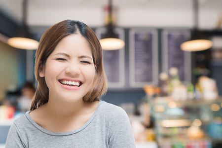 selfemployed: happy self-employed woman with bakery shop background Stock Photo