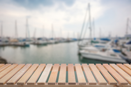 private party: wooden pier with yacht background Stock Photo