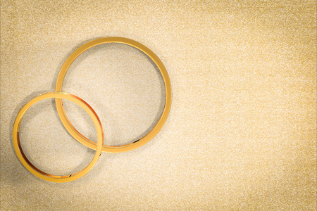 weddingrings: golden wedding rings with blank space on gold glitter background