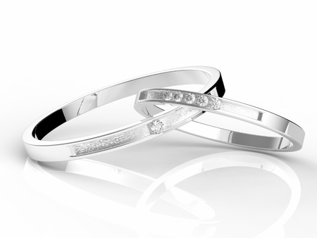 platinum: platinum wedding rings on white background