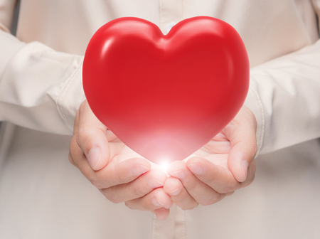 hand holding 3d rendering red heart Stock Photo