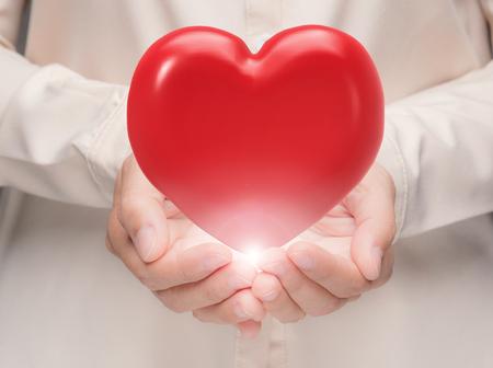 hand met 3D-rendering rood hart Stockfoto