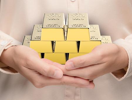 bullion: hand holding 3d rendering heap of bullion