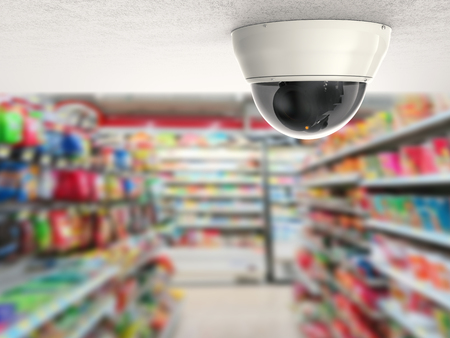 security camera or cctv camera on ceiling with retail shop background