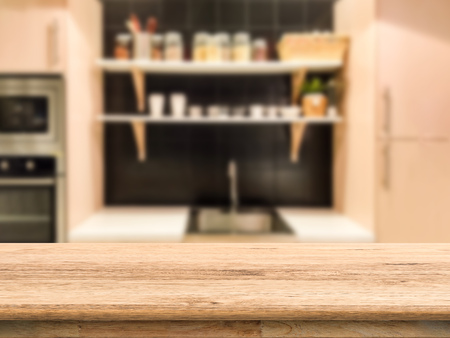 kitchenette: wooden counter top with kitchen cabinet background
