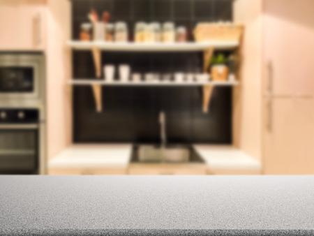 granite kitchen: granite counter top with kitchen cabinet background