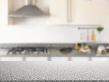 counter top: granite counter top with kitchen cabinet background