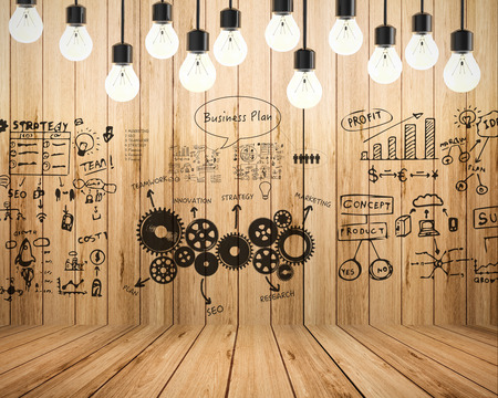 business innovation: business plan with chart on wooden background