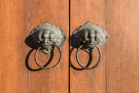 door handle: antique handle on wooden door