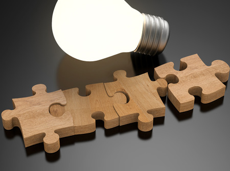 shining light: 3d rendering blank jigsaw pieces with shining light bulb Stock Photo