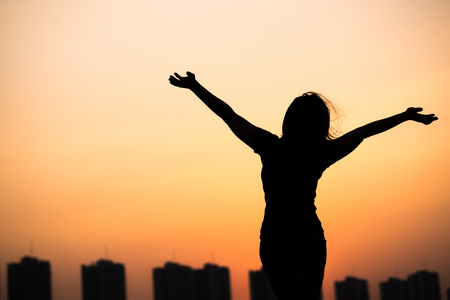 woman hands up: silhouette success woman hands up with sunset sky background
