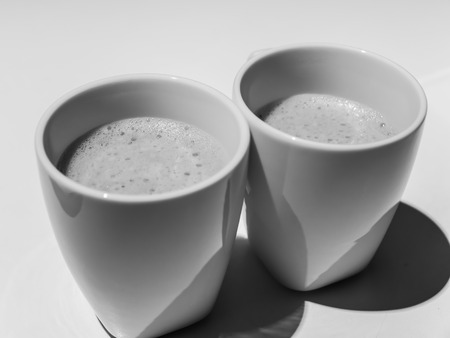 coffee cups: hot coffee in white cups Stock Photo