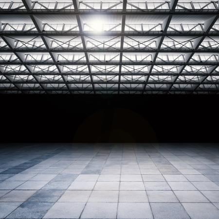 empty warehouse: dark and empty warehouse with cement floor Stock Photo