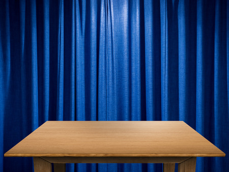 curtain background: empty wooden table with blue curtain background