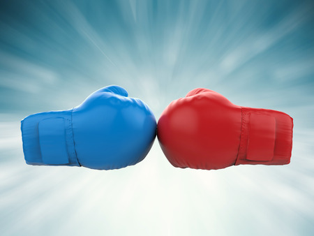 defines: battle concept with blue and red boxing gloves Stock Photo