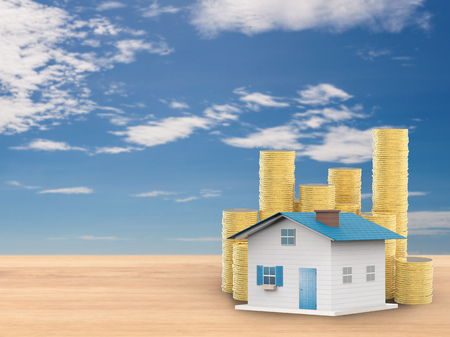 gold house: mock up house with gold coins on blue sky background