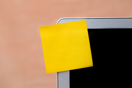 yellow notepad: blank yellow notepad stick with computer screen