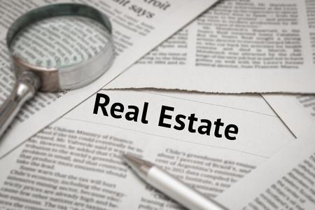 headline: real estate news headline on newspaper Stock Photo