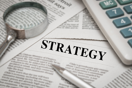 headline: strategy headline on newspaper background Stock Photo