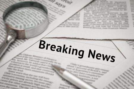 breaking: breaking news headline on newspaper background