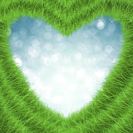 blue green background: green grass heart shape on blue background Stock Photo