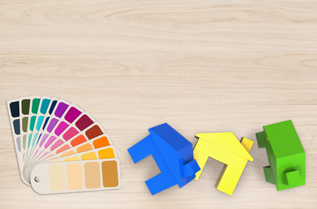concept de la peinture à la maison avec colorées maquettes des maisons et nuancier Banque d'images