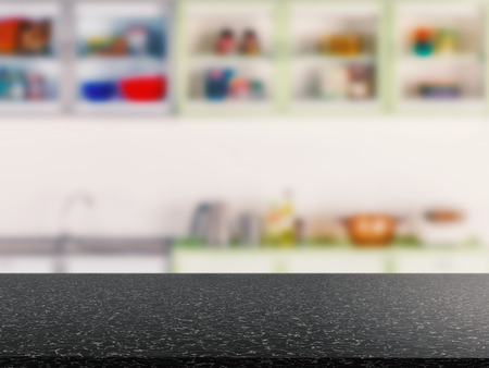 black granite counter top with kitchen cabinet background