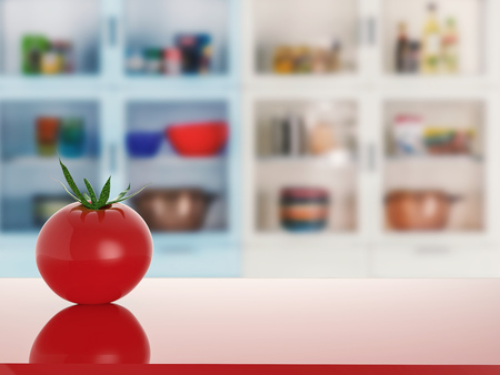 tomato on red counter with kitchen background Stock Photo