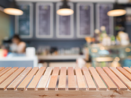 counter top: wooden counter top with coffee shop background