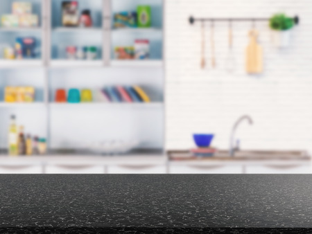 granite counter: black granite counter top with kitchen cabinet background