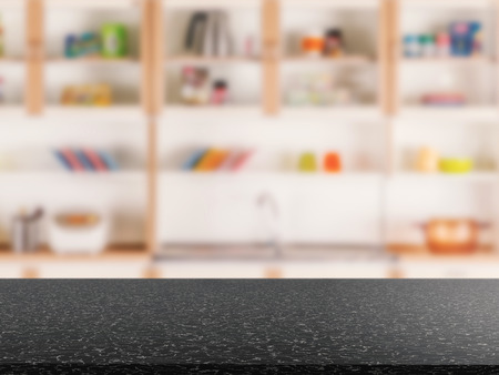 counter top: black granite counter top with kitchen cabinet background