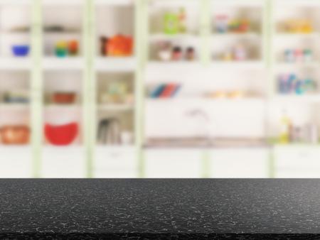 granite kitchen: black granite counter top with kitchen cabinet background