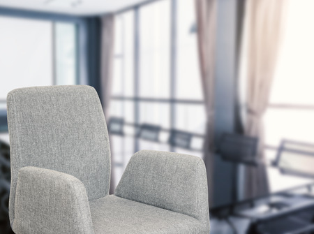 common room: grey fabric office chair with office background