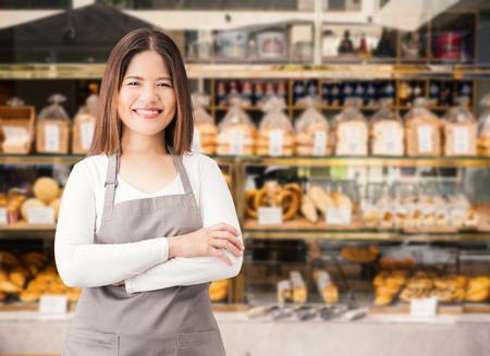 female business owner with bakery shop background Banco de Imagens
